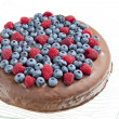 Stock Photo: Chocolate cake with raspberries and blueberries