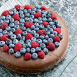 Chocolate cake with raspberries and blueberries — Stock Photo
