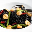 Sepia spaghetti with prawns, asparagus and chilli — Stock Photo