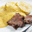 Sirloin on cream with dumplings - Zdjęcie stockowe