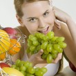Stock Photo: Woman during breakfast with fruit