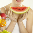 Woman during breakfast with fruit — Stock Photo