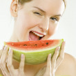 Portrait of woman with melon — Stock Photo