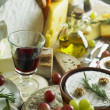 Cheese still life with red wine — Stockfoto