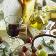 Foto Stock: Cheese still life with red wine
