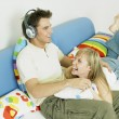 Stock Photo: Couple listening to music