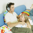 Royalty-Free Stock Photo: Couple listening to music