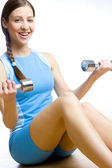 Woman with dumb bells at gym — Stock Photo