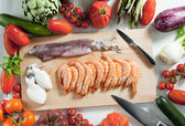 Still life of raw seafood and vegetables — Stock Photo