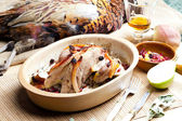 Baked pheasant with bacon, pear, raisins on brandy — Stockfoto