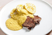 Sirloin on cream with dumplings — Stock Photo