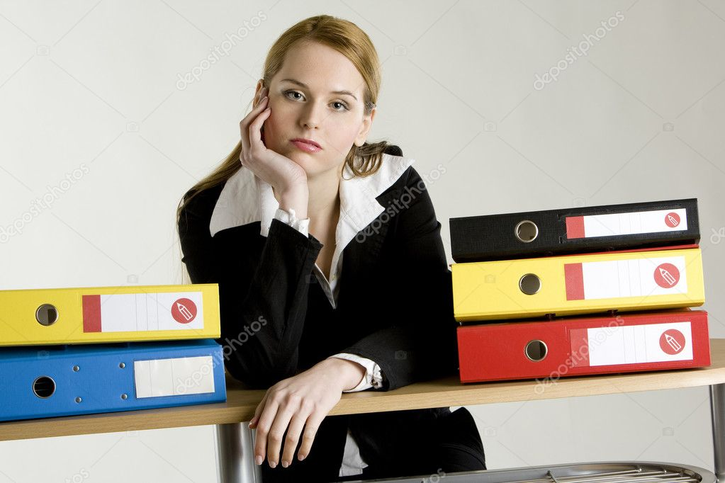 Businesswoman with folders  Stock Photo #10988924
