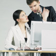 Businesspeople at computer — Stock Photo #10990255