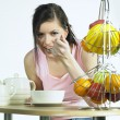 Woman during breakfast — Stock Photo #10990276