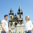 Stock Photo: Couple in Prague, Tynsky church, Old Town Square, Czech Republic