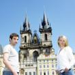 Couple in Prague, Tynsky church, Old Town Square, Czech Republic — Stock Photo