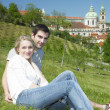Couple in Prague, St. Nicholas church, Prague, Czech Republic — Stock Photo #10990523