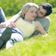Couple lying on meadow — Stock Photo #10990525