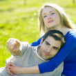 Couple sitting on meadow — Stock Photo #10990532