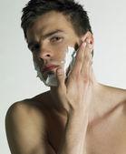 Portrait of man with shaving foam — Stock Photo