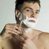 Portrait of shaving man — Stock Photo