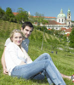 Couple in Prague, St. Nicholas church, Prague, Czech Republic — Stock Photo