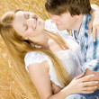 Young couple sitting in grain field — Stock Photo