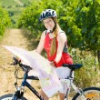 Royalty-Free Stock Photo: Biker holding a map in vineyard, Czech Republic