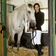 Stock Photo: Equestrian with horse in stable