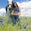 Equestrian with a horse on meadow — Stock Photo