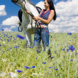 Equestrian with a horse on meadow — Stock Photo #11284152