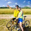 Bikers holding a map, Hazmburk, Ceske stredohori, Czech Republic — Stock Photo