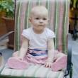 One year old toddler girl sitting on chair — Stock Photo