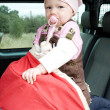 Stock Photo: Little girl standing in car seat