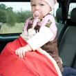 Little girl standing in car seat - Stock Photo