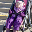 Toddler sitting in pram — Stock Photo #11285853