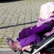 Toddler sitting in a pram on walk — Stock Photo