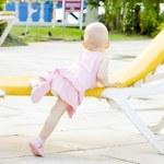 Little girl on beach chair, Tobago — Stock Photo