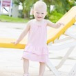 Little girl standing at beach chair, Tobago — Stock Photo
