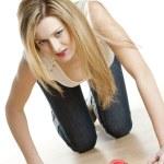 Kneeling woman with heart — Stock Photo #11289875