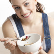 Portrait of woman eating cereals — Stock Photo