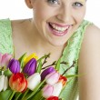 Portrait of young woman with tulips — Stock Photo
