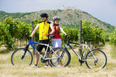 Bikers, ruins of Devicky castle with vineyard, Czech Republic — Stock Photo
