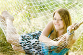 Woman resting in hammock — Stock Photo