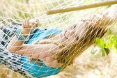 Portrait of woman resting in hammock — Stock Photo