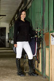 Equestrian with saddle in a stable — Stock Photo