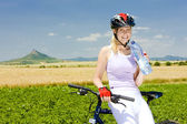 Biker with bottle of water, Hazmburk, Ceske stredohori, Czech Re — Stock Photo