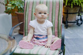 One year old toddler girl sitting on chair — Stockfoto