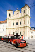 Tourist train in front of Trinity Church, Bratislava, Slovakia — Stock fotografie