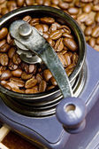 Detail of coffee mill with coffee beans — Stock Photo